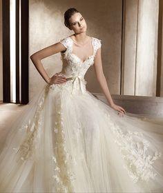 Shining sweetheart short sleeved lace  wedding dress. So pretty.