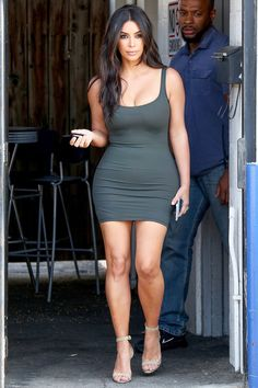 In a grey body-con dress and nude sandals while out in Los Angeles.