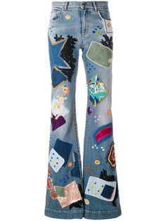 Shop Roberto Cavalli patchwork flared jeans.