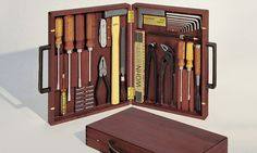 This beautifully crafted WohnGeist tool case is made from solid Swiss pear wood and features leather handles.