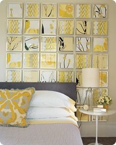 "Scrapbook paper and cheap frames – Like this as a ""headboard"". Also like the gray and yellow. Might be time to change up our bedroom..."