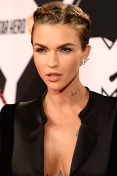 Who: Ruby Rose What: Pixie Braids How-To: The actress showed there's more to do with a short cut than simply let it be or spike it up. Make thin, tight French braids on either side of the part, connecting them at the nape if you have the length or just securing them at the back of the head with bobby pins.  Editor's Pick: Verb Forming Fiber, $14, sephora.com.   - HarpersBAZAAR.com