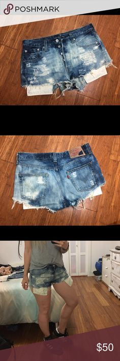 Distressed Levi's 501 denim shorts Medium Beautifully distressed vintage Levi's 501 cutoffs faded blue medium, these are the 90s style button fly. Originally purchased from Urban Outfitters, like new barely worn.  Denim with a little stretch. Should fit size 26-27 nicely or size 24-25 baggy fit like One Teaspoon. 15 inch waist band. No trades 😘✌🏻 Levi's Shorts Jean Shorts