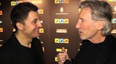 """Pink Floyd rocker Roger Waters chats with Arthur Kade at the premiere of """"12-12-12"""". The Weinstein Company documentary explores the Hurricane Sandy Relief Concert."""
