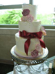 Three layer cake with ribbon and sugar roses. Peridot Sweets, Las Vegas, Nevada. (702) 220-4820. Delicious!