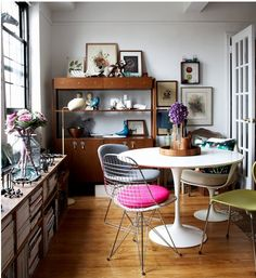 I enjoy that it is filled with light and the mismatched chairs around the table.