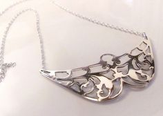 Upcycled silver-plate and sterling silver necklace. Formerly an antique serving tray.