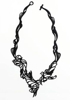 """""""Batucada jewelry uses organic shapes and natural-feeling eco-plastic material to achieve a lace-like effect when worn."""""""