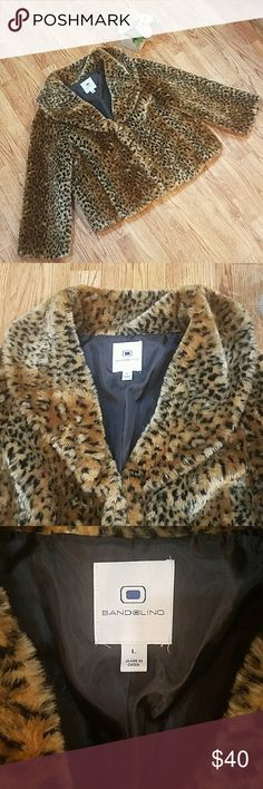 Bandolino Faux Fur Jacket Cheetah Large Collar Collared faux fur cheetah print jacket. Plush and warm. Closes with 3 hooks. A little wear on the fur near clasps,  but over all great used condition. Bandolino Jackets & Coats