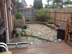 2014 update on backyard - added water feature and repurposed stones that were around the air conditioner.  A vine will grow on the Air surround.