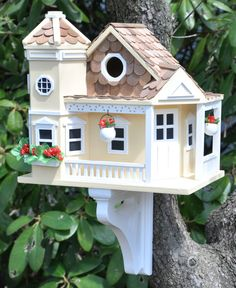 The honeysuckle cottage style birdhouse is typical of the fine Victorian Era architecture that give Sea Cliff the classic look of a by-gone era. The Sea Cliff Cottage Birdhouse is constructed of exterior grade ply-board with poly-resin details. Bird Houses Diy, Fairy Houses, Yellow Cottage, Bird House Kits, Bird Cages, Bird Feeders, Mellow Yellow, Yellow Sea, Color Yellow