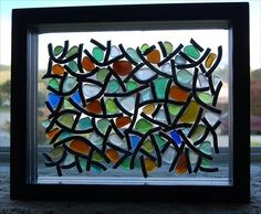 Striking use of sea glass in window pane