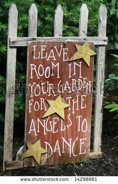 """sign saying """"leave room in your garden for the angels to dance"""""""