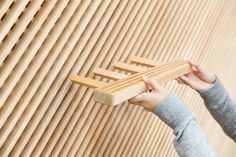 The deftly crafted display system of easily adjusted interlocking shelves, custom built by local artisans, offers seemingly endless possibilities. -- Tadafusa knife shop in Sanjo