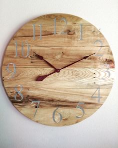 A personal favorite from my Etsy shop https://www.etsy.com/listing/463007988/rustic-pallet-clock-with-a-pop-of-red