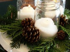Decorating for a wedding wedding on a budget?  Some vintage Mason canning jars, white candles, pine boughs and pine cones are lovely and simple.