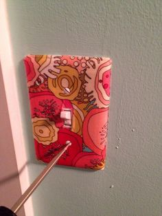 Screw plate back onto switch. Tada! See my other Snapguides for no-sew fabric-covering projects.