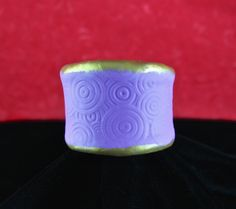 Circles cuff bracelet made by Suzann Sladcik Wilson with Makin's Clay® no bake air dry polymer clay - http://www.makinsclayblog.blogspot.com/2015/09/seeing-circles-makins-clay-cuff.html