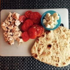 Naan Bread Pizza   Ingredients:  Naan bread  Cooked diced chicken  Sliced fresh tomatoes  Mozzarella Cheese     Directions: Set oven to 400 degrees F 1. Place naan bread on a baking sheet.  Top with tomatoes, diced chicken and then cheese.   2. Bake for 5-8 minutes until cheese is melted.