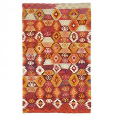 An allover sequence of geometric motifs comes alive in a warm, earthy palette on this wool kilim.