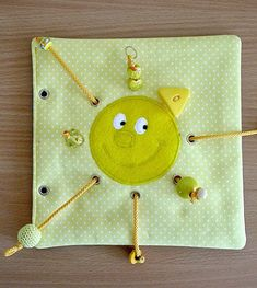 Quiet book page idea to develop fine motor skills. Pulling the strings by different shaped beads and buttons. Love it! Made by Irinelli.