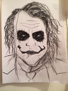 Pinning this because why not?? Definitely NOT my best but it's a charcoal VERY QUICK sketch of the joker before I start a proper one :D - Ashleigh Hunter