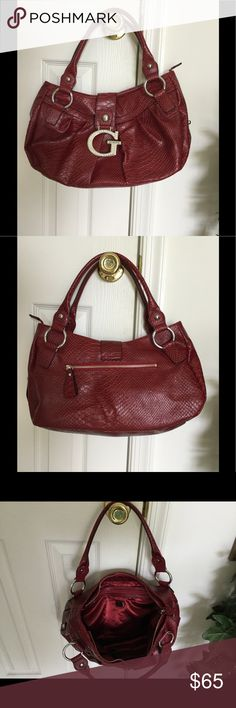 Guess Hand Bag Sassy Dark Red & Black Snake/Crocodile Look Hand Bag. Approximately 8 1/2 X 17.   Excellent Condition. Crystal CZ stone on buckle. Guess Bags