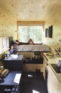 Cabin interior with plenty of built-in storage. Tagged: Bedroom, Dark Hardwood Floor, Bed, and Recessed Lighting. Photo 2 of 20 in 10 Adorable Tiny Homes You Can Rent Right Now. Browse inspirational photos of modern bedrooms. Buy A Tiny House, Building A Tiny House, Tiny House Cabin, Tiny House Living, Tiny House On Wheels, Small House Plans, Living Room, Cabin Design, Tiny House Design