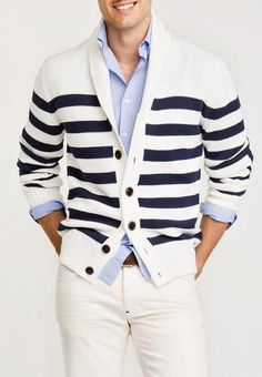 Nautical themed with navy blue and white stripe cardigan, light blue button down, and off white jeans.