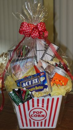 Home Movie night basket. I must find a bucket like this! ;)