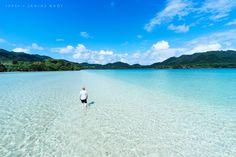 Walking in tropical lagoon, Ishigaki Island, Okinawa, Japan