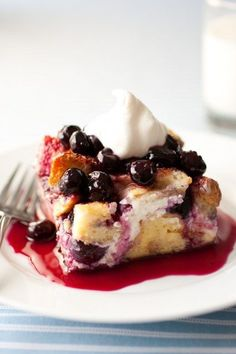Overnight Blueberry French Toast - filled with cream cheese and blueberries and topped with a simple homemade blueberry syrup. delish!!.