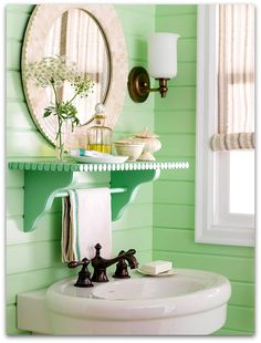 im so big on the flat mirror in the bath room because its so cute but that simple shelf under it is soo awsome and a good way to keep hand towels from bath towels!!!! im in luv