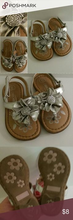 Gold Beaded Flower Cherokee Sandals Velcro EUC So Cute & lots of detail.  Excellent Used Condition  (Consider bundling to get more value out of the cost of Shipping and feel free to make offers on bundles) Thank you for visiting my closet!! SMOKE FREE CLEAN HOME Cherokee Shoes Sandals & Flip Flops