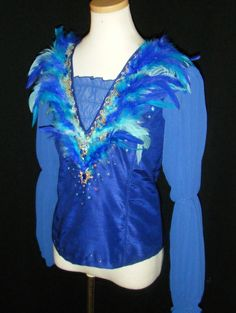 This professional Blue Bird tunic is created for the male role of The Blue Bird. It is a highly professional stage costume made of silk taffetas, with chiffon sleeves and real swan feathers in differe Ballroom Costumes, Ballet Costumes, Boy Costumes, Dance Costumes, Costume Ideas, Samba, Mens Tunic, Matching Costumes, Ballet Boys
