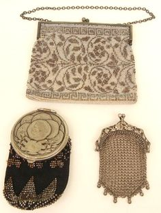 Three early 20th C. purses including one evening bag with white background and hammered steel forming floral design, Greek key border; one coin purse with black cloth body and hammered steel beads, Roman coin motif on cover with mirror inside; and one sterling silver mesh with ornate frame.
