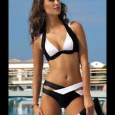 SEXY Bandage Push Up Stunning Black and White Bandage Push Up Bikini. Top has adjustable shoulder straps, ties at neck, push up cups and has 2 places to hook at back. Bottoms crisscross at front with wide black and white bands. SEE SIZE CHART in PICTURE 4. MATERIAL - 82% Polyester 18% Spandex Swim Bikinis