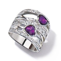 """Silvertone open work wide band statement ring with purple faux stones and rhinestones. • Band: 1"""" wide at the front of the ring and shank is 1/4"""" wide at smallest point • Imported"""