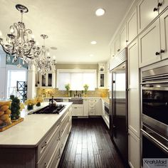 Classy KraftMaid kitchen with a touch of glamour.