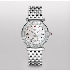 Caber Diamond  One hundred and forty glittering diamonds encircle this classic timepiece. Roman numerals and the signature Michele logo grace the mother of pearl dial. The stainless steel bracelet is interchangeable with any 18mm Michele strap.