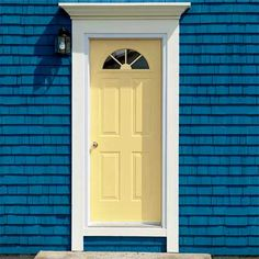 If your siding is a bright color - like this deep teal blue - pale yellow paint on the entry door is a great accent.  For exterior house painting in Bellingham WA - including siding and doors - visit http://www.northpinepainting.com