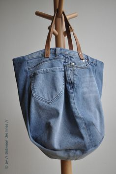 Repurposing an old pair of jeans into a bag  (I love this idea)