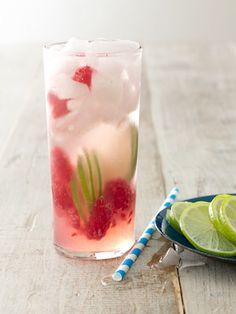 Raspberry gin rickey Ingredients 1 cup(s) sugar 1/2 cup(s) (about 7 ounces) raspberries 1 cup(s) (about 8 limes) fresh lime juice 12 ounce(s) (1 1/2 cups) gin  Ice 1 quart(s) (4 cups) seltzer 2 limes, sliced very thinly (for garnish)
