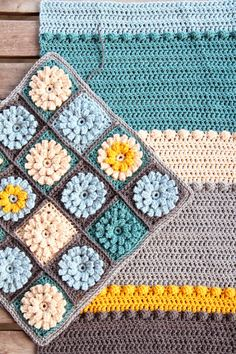 I love the color palette and the bobbles  {pillowcase and throw inspiration, by creJJtion}