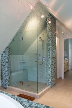 If you have a sloped ceiling in the shower, put a custom bench at the lowest part.