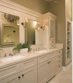 Bathroom. Like the cabinet on top of the counter and the drawers. Wall color is nice too