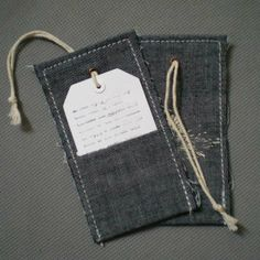 Denim fabric hangtag combined with paper tag