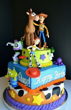 Toy Story Birthday Cake: Tiered yellow cakes filled with chocolate mousse, frosted in buttercream and topped with figurines. For a very special occasion!
