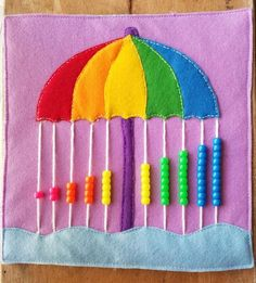 This handmade Quiet Book page has been created to help teach number counting!This handmade Quiet Book page has been created to help teach number counting! The Rainy Day Umbrella is made abacus style Diy Quiet Books, Baby Quiet Book, Felt Quiet Books, Quiet Book Templates, Quiet Book Patterns, Toddler Learning Activities, Infant Activities, Preschool Games, Family Activities