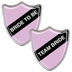 A bride to be badge with accompanying team bride badges.